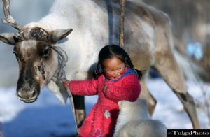 Reindeer Girl in Winter Camp of the Reindeer Herders of Mongolia