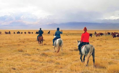 Horse riding through amazing scenery of Mongolia