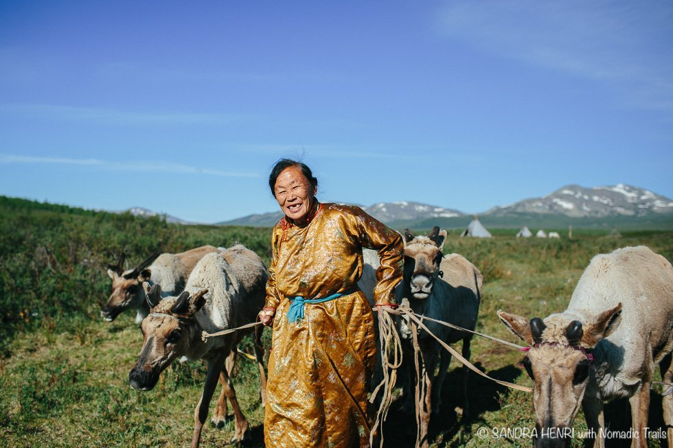 Dukha woman with her reindeer at their spring camp