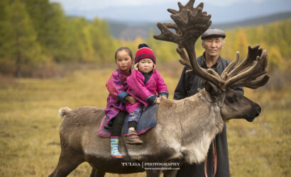 Reindeer tribe grandfather with children