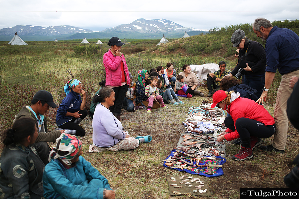 Reindeer local trading with traveler guests