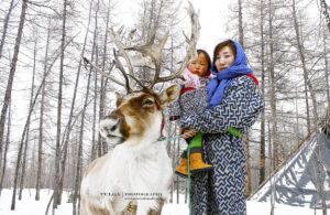 reindeer women with her baby