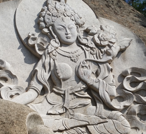 White tara carving of granite hills of Aglag Monastery complex Mongolia