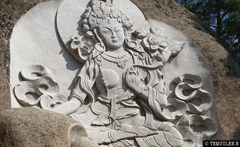 White tara carving of granite hills of Aglag Monastery complex Mongolia