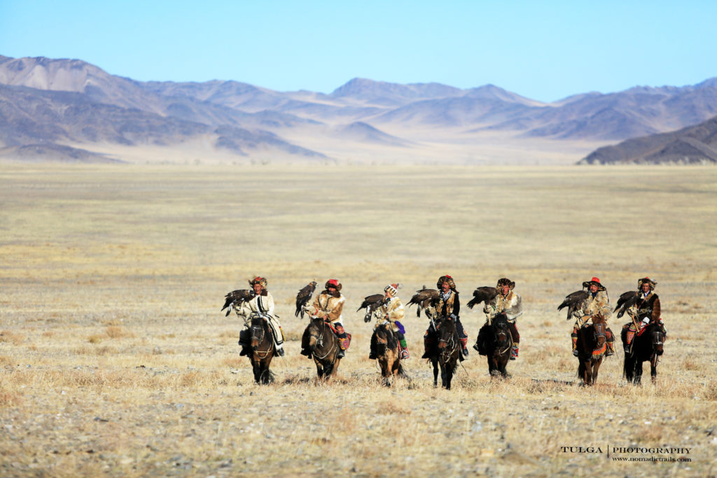 Eagle hunters posing for Nomadic Trails travelers | The Art of Hunting with Golden Eagles - Nomadic Trails