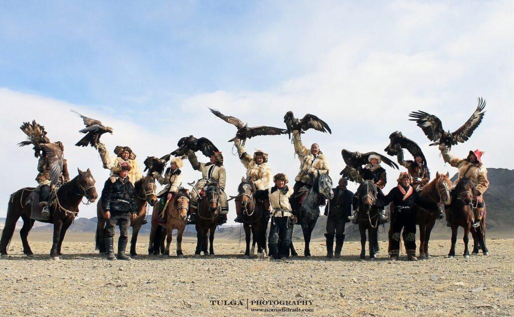 Majestic group of Eagle Hunters at eagle festival Mongolia