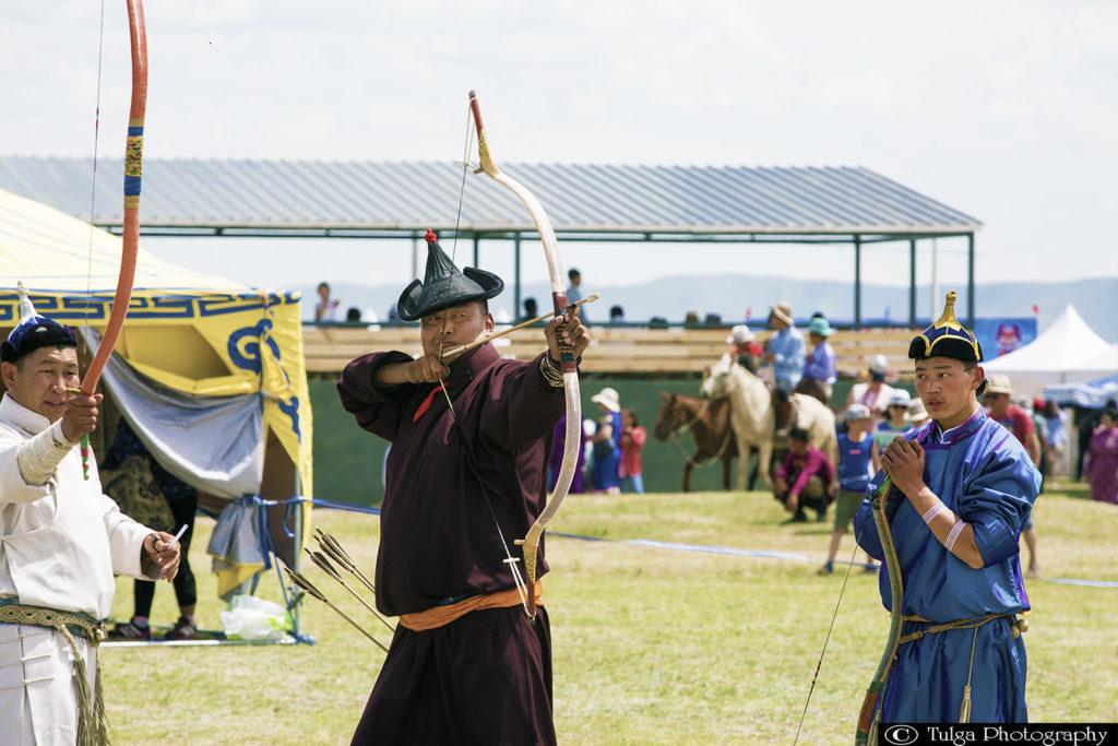 Archer is shooting at Naadam Festival | Naadam Festival Mongolia - Nomadic Trails