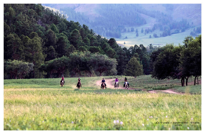 Group of riders horseback riding to the Dukha tribe in North Mongolia