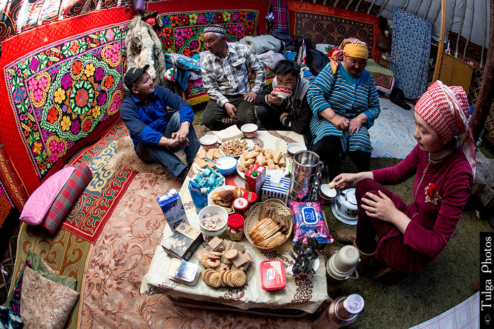 Inside a Mongol ger with local Kazak family on tour with Nomadic Trails