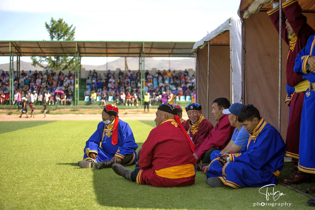 Men at naadam in deel - traditional mongolian garment
