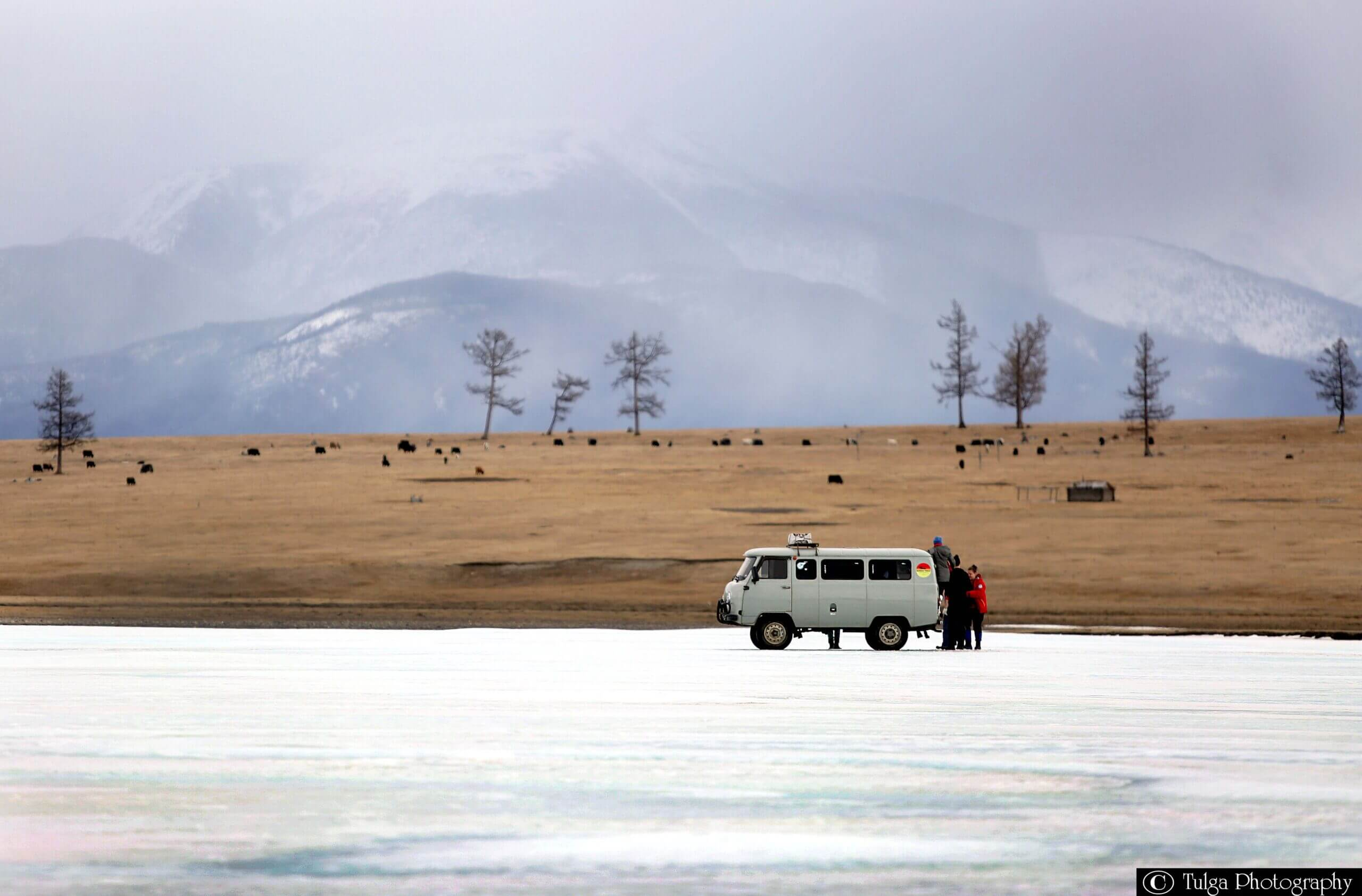 Mini van on ice during Nomadic Trails winter tour