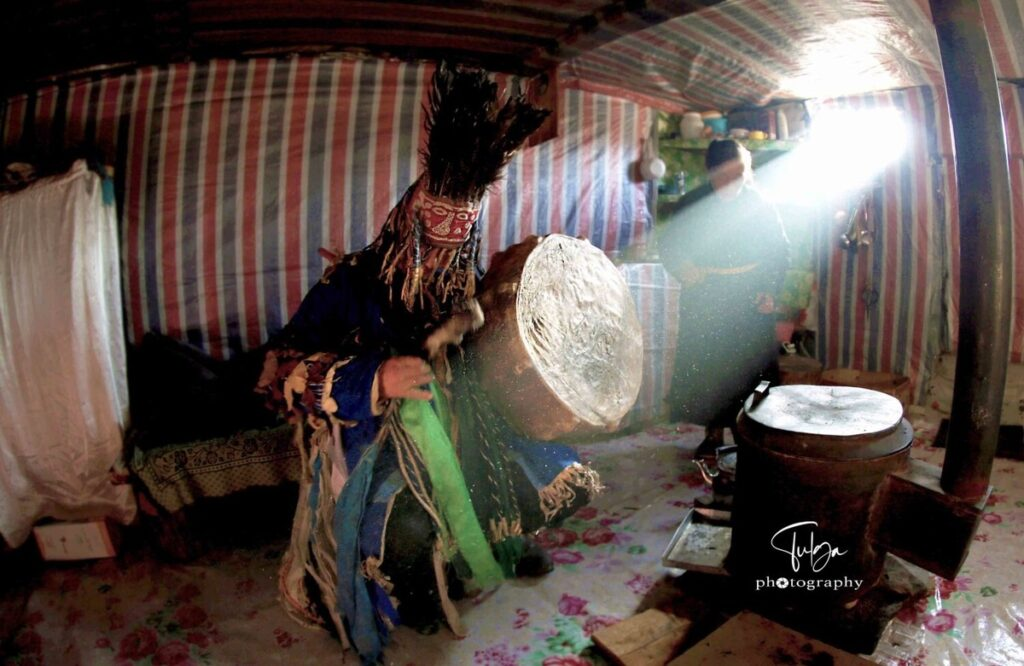 Mongolian shaman with light peeking through window