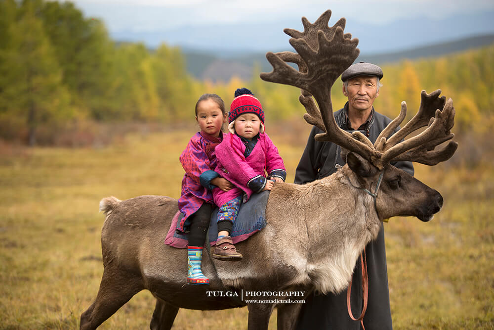 Grand kids with grandpa for blog the best reindeer herder photos