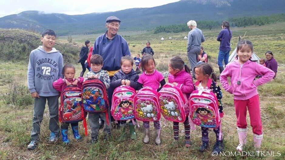 Reindeer children with their gifts from the Reindeer Tribe of Taiga foundation | Foundation to help the Reindeer People - Nomadic Trails