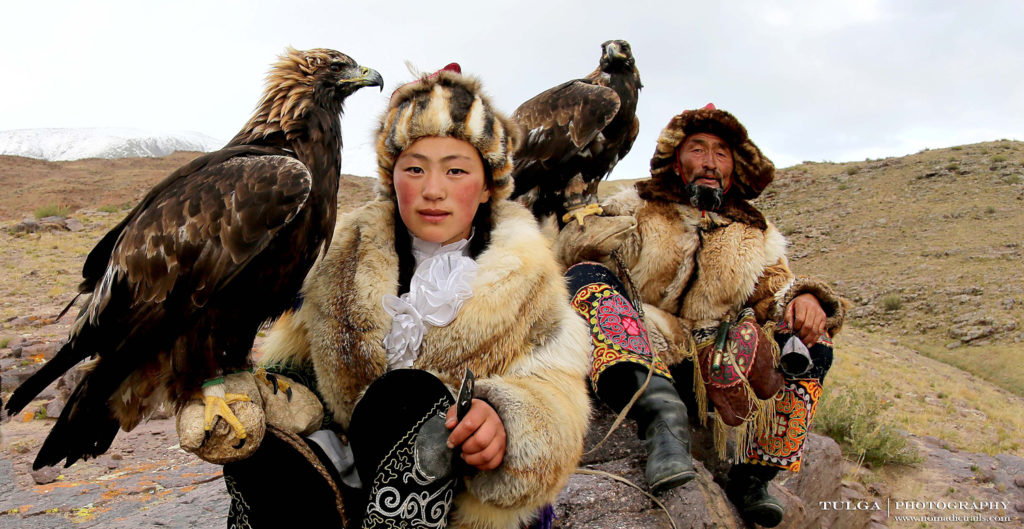 Young and old eagle hunter | Golden Eagle Festival Mongolia - Most necessary information - Nomadic Trails