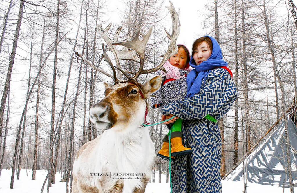 reindeer herder woman with her daughter