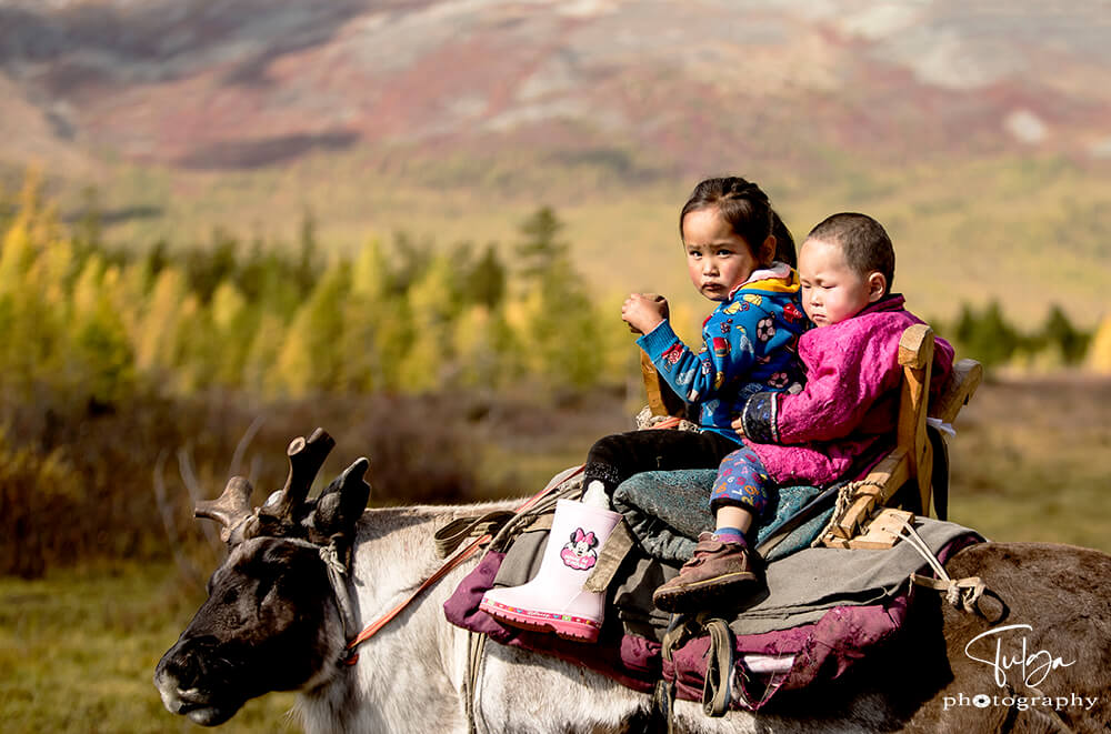 young reindeer riders boy and girl | Top 5 Photography Tours Mongolia - Nomadic Trails