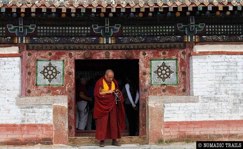 lama leaving chanting temple at Gandan monastery complex - Ulaanbaatar city tour